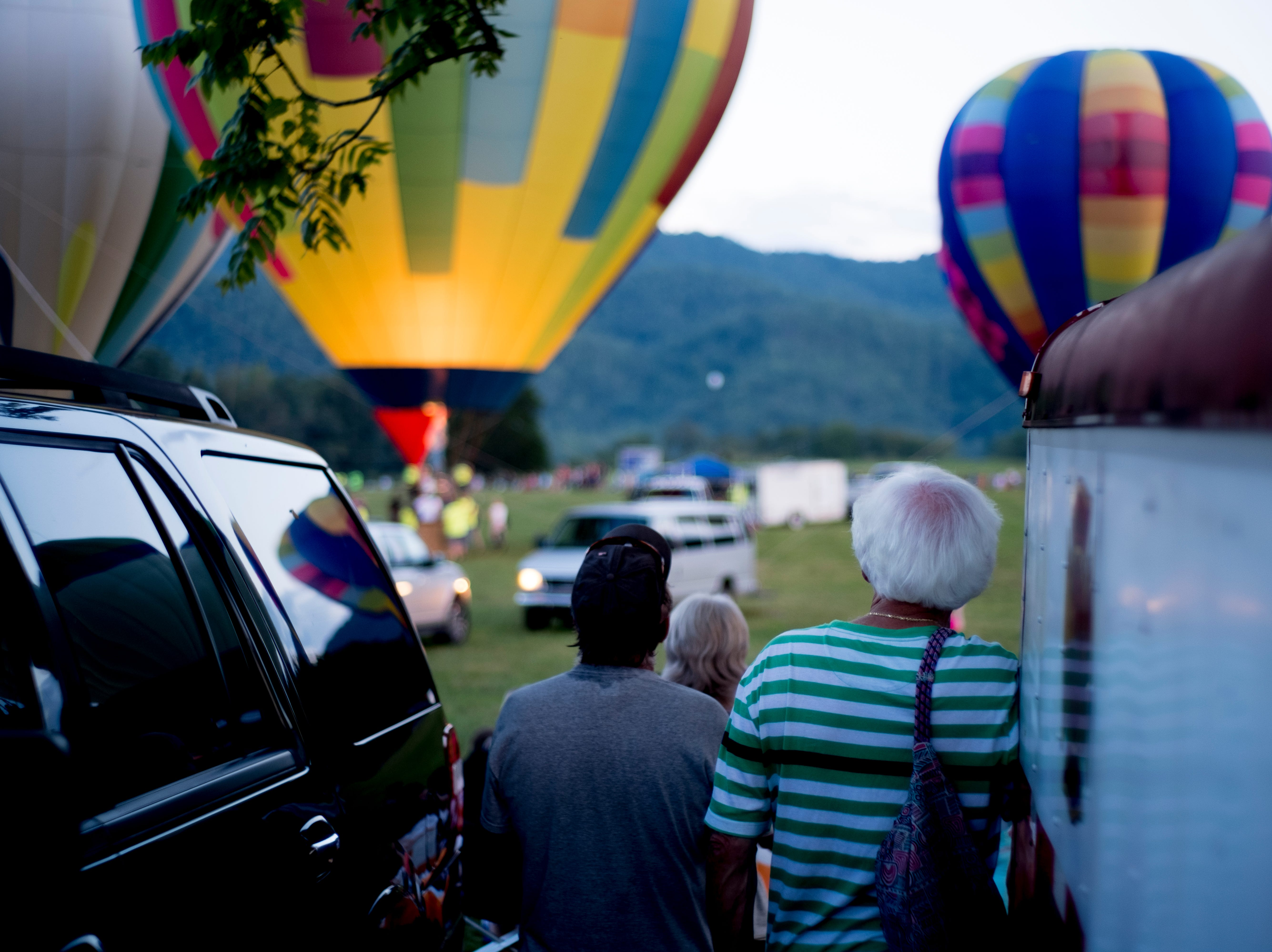 Visitors watch as the hot air balloons rise into the air at the second annual Smoky Mountain Balloon Festival in Townsend, Tennessee on Saturday, August 18, 2018. The festival featured several hot air balloons, food trucks, wine tasting and live entertainment.