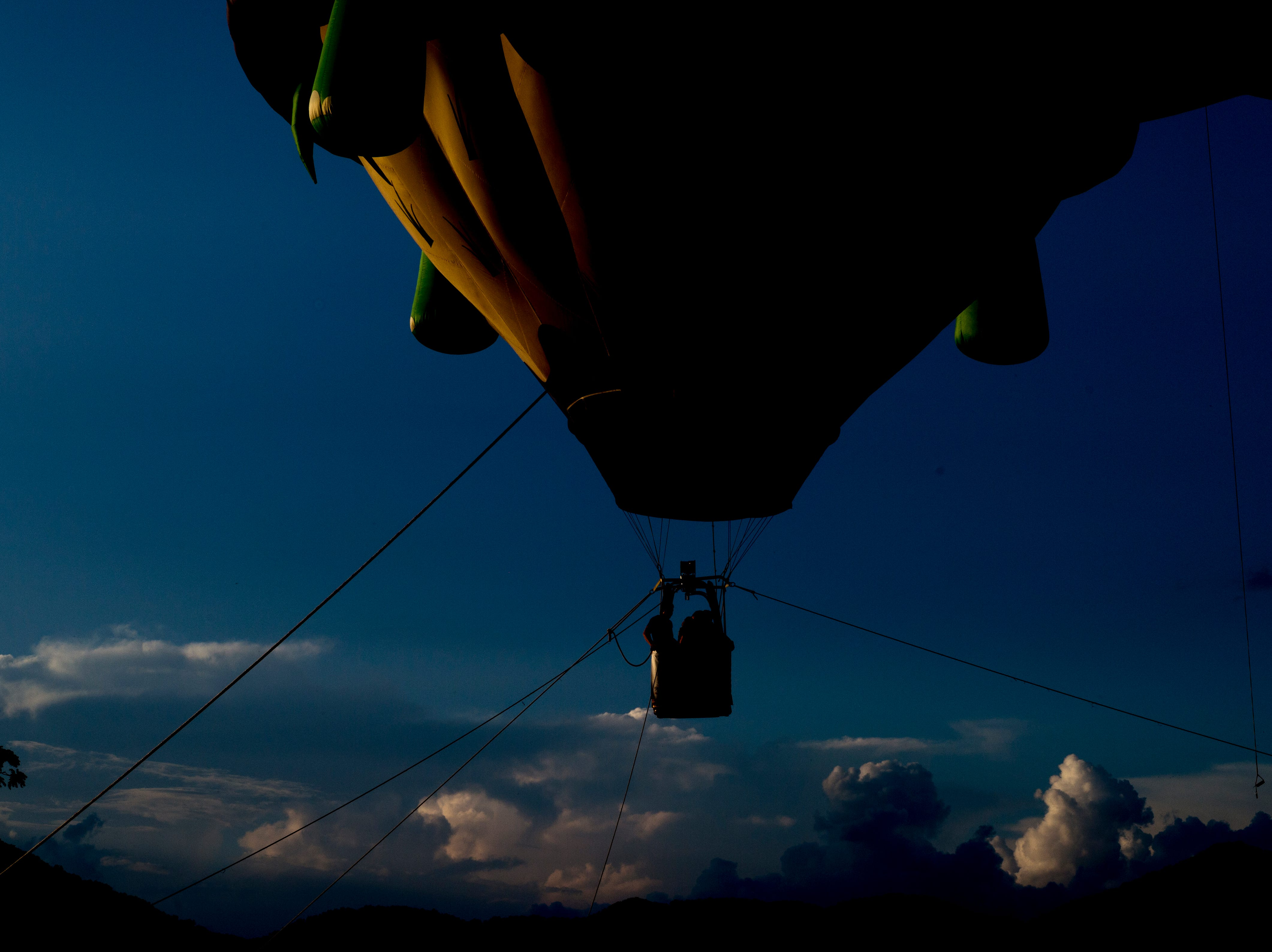 A hot air balloon rises into the sky at the second annual Smoky Mountain Balloon Festival in Townsend, Tennessee on Saturday, August 18, 2018. The festival featured several hot air balloons, food trucks, wine tasting and live entertainment.