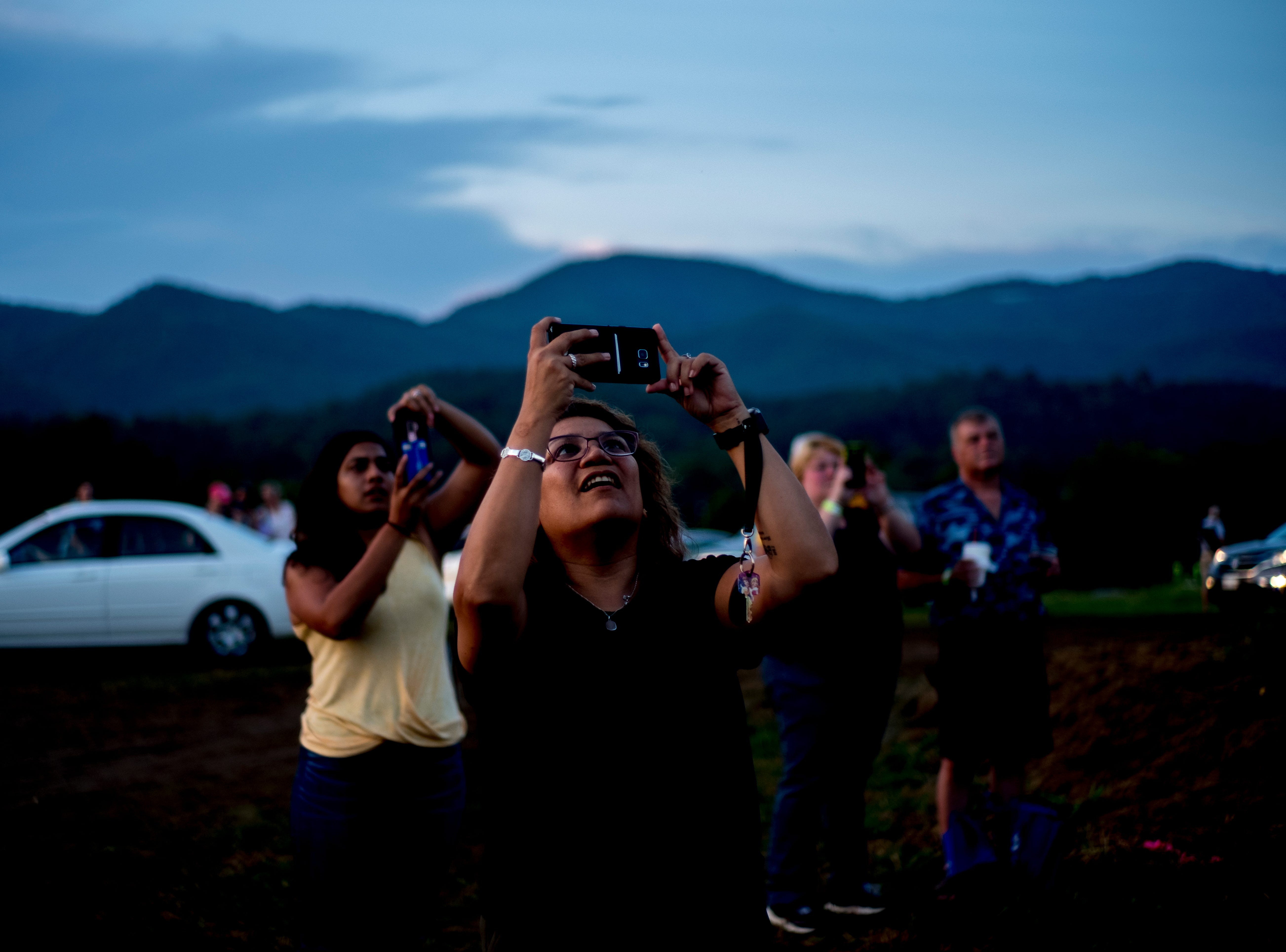 Visitors snap photos of the hot air balloons at the second annual Smoky Mountain Balloon Festival in Townsend, Tennessee on Saturday, August 18, 2018. The festival featured several hot air balloons, food trucks, wine tasting and live entertainment.