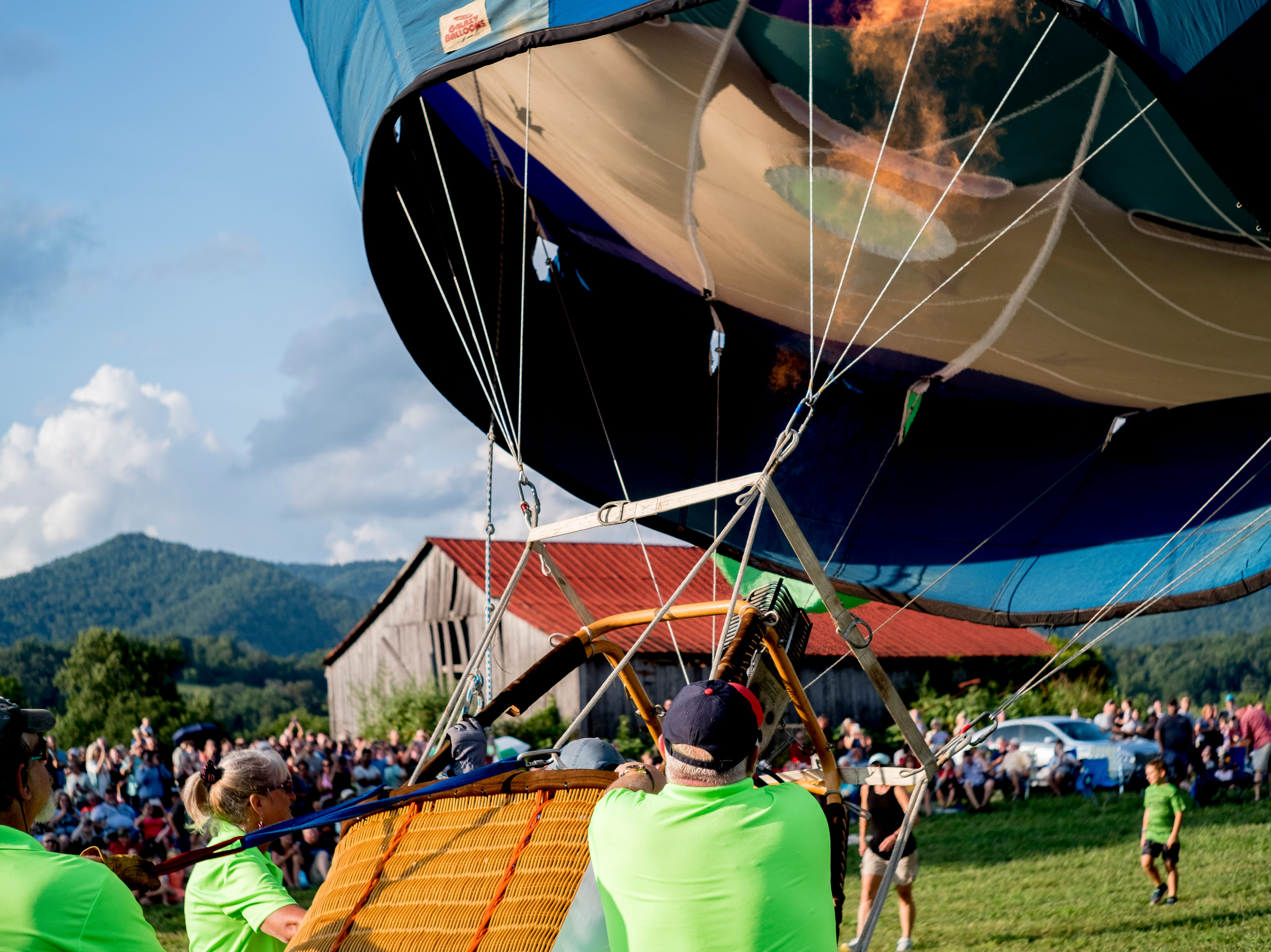 A hot air balloon begins to rise at the second annual Smoky Mountain Balloon Festival in Townsend, Tennessee on Saturday, August 18, 2018. The festival featured several hot air balloons, food trucks, wine tasting and live entertainment.