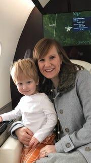 Casey Pruitt holding her 3-year-old son Ridge Pruitt.