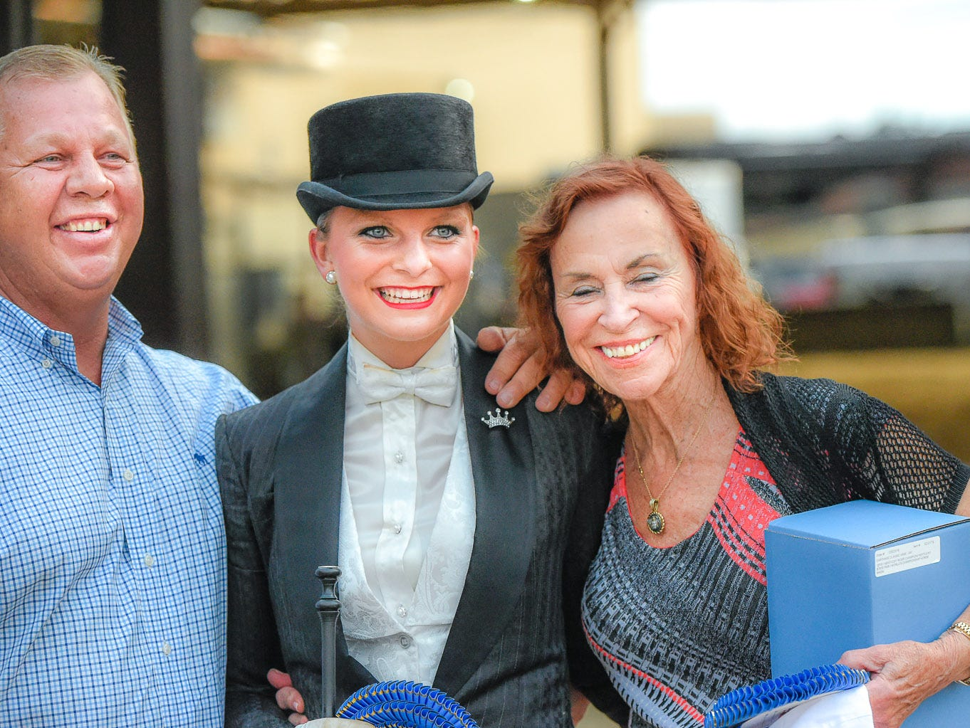 Trainer Mark Turner with Alayna Applegate, winner of the Kentucky Riders Equitation World Championship and trainer, Lillian Shively.