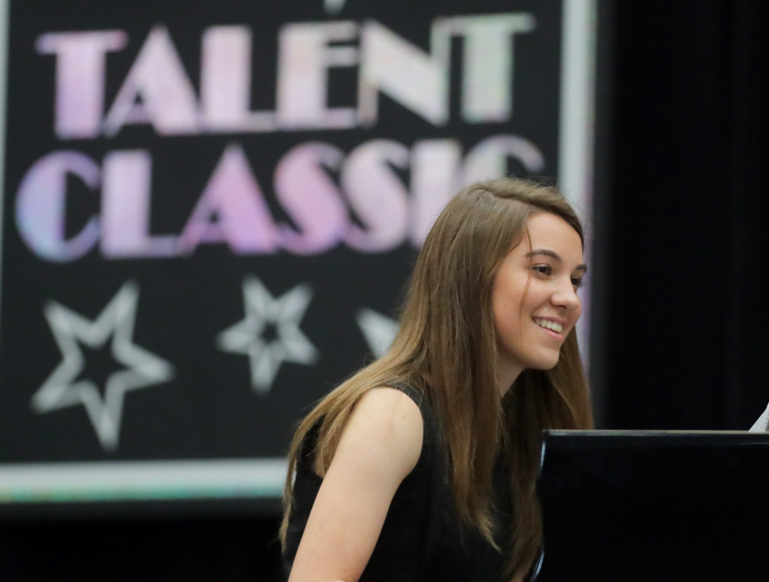 Macy Kyle performs in one of the Coca-Cola Talent Classic semifinals at the  Kentucky State Fair.