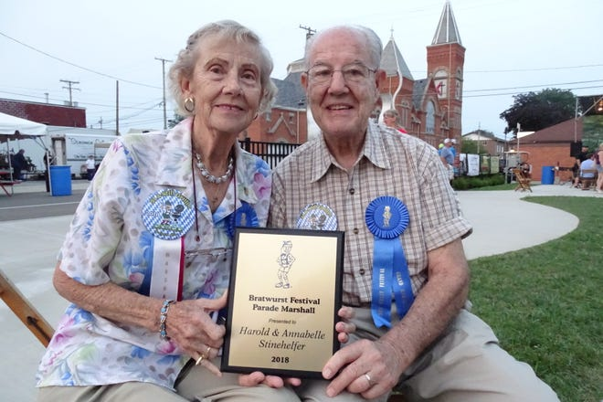 Harold and Annabelle Stinehelfer hold the plaque they were awarded for being the grand marshals of the parades during the 2018 Bucyrus Bratwurst Festival.