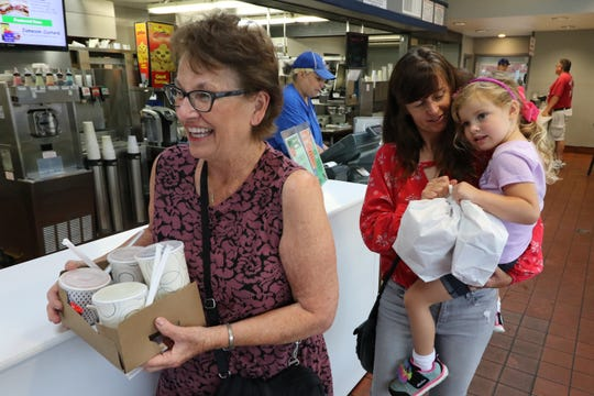 Judee Wickus (left) and Welee and Chesnee Blosenski depart with their lunch order from Gillies Frozen Custard at 7515 W. Bluemound Road.