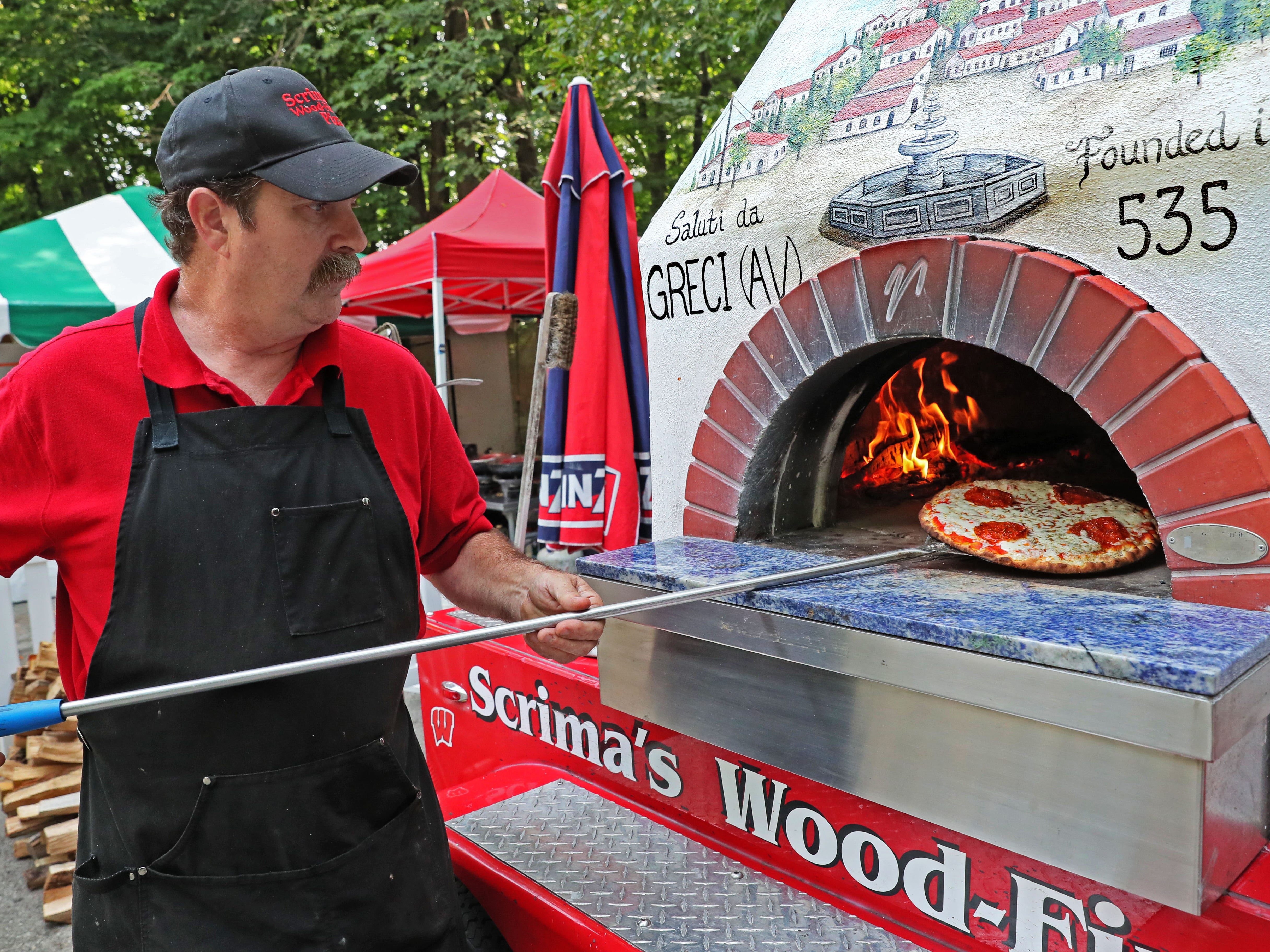 There were 34 restaurants and food vendors at the 34th annual Milwaukee Journal Sentinel a la Carte at the Milwaukee County Zoo. Jim Whitehurst makes a pizza at Scrima's Wood-Fired Pizza.