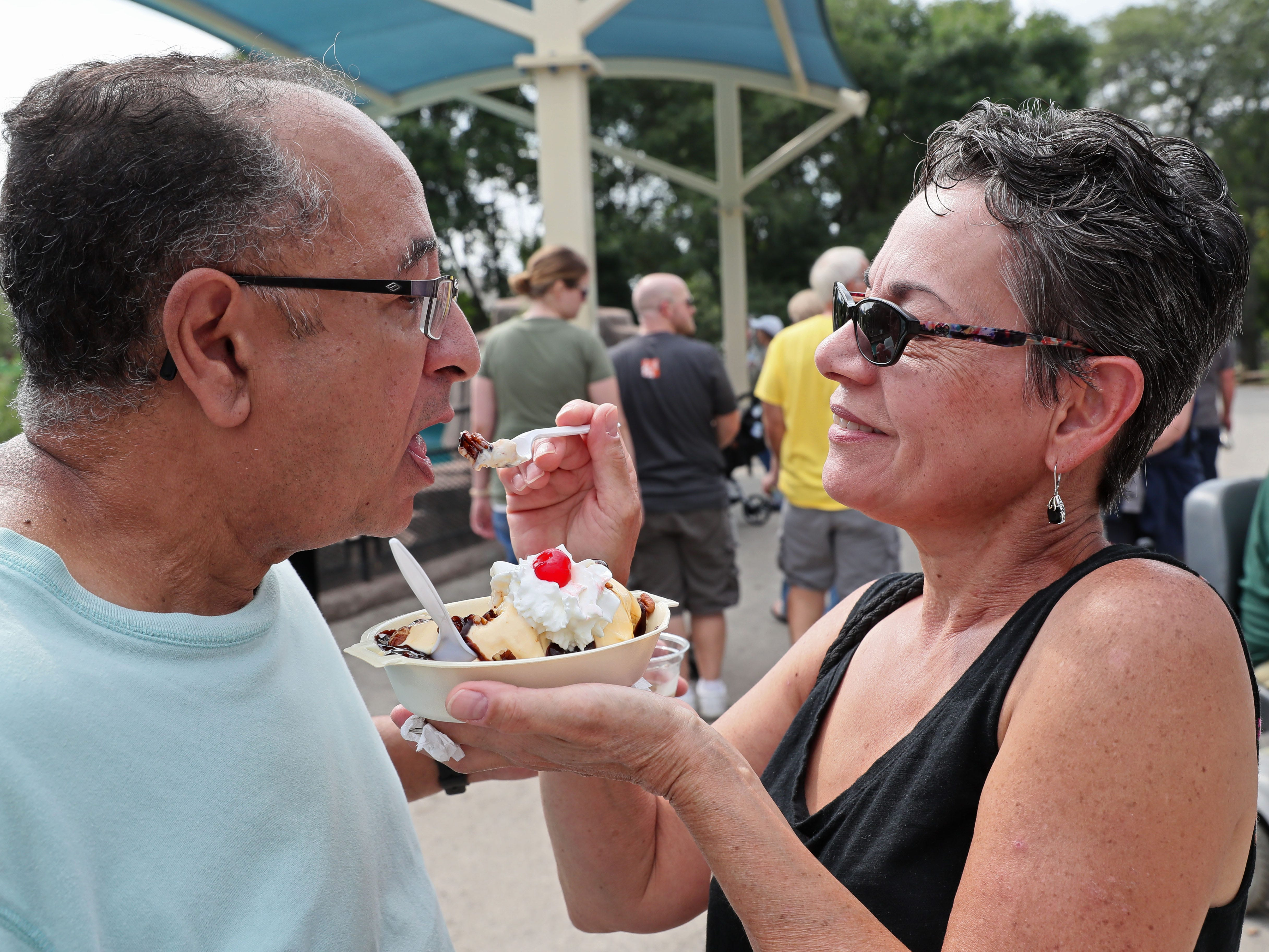 Toni Crespo gives her husband, Gil, a taste of her Turtle Sundae from Ultimate Confections. The couple are from Franklin.