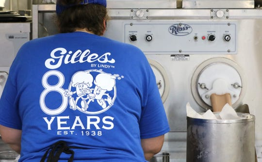 Stephanie Becker makes and packages vanilla and chocolate flavors at Gillies Frozen Custard at 7515 W. Bluemound Road, which is celebrating its 80th year of business.