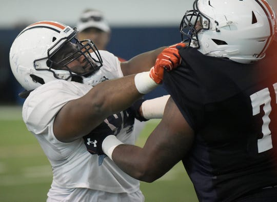Auburn defensive lineman Tyrone Truesdell and offensive lineman Marquel Harrell during practice.
