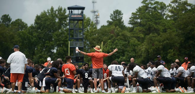 Auburn coach Gus Malzahn talks to his team after practice on Saturday, Aug. 18, 2018 in Auburn, Ala. Todd Van Emst/AU Athletics