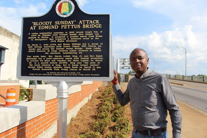 Zimbabwe lawyer Kudzayi Kadzere examines a historic marker at the base of the Edmund Pettus Bridge in Selma. Alvin Benn/Special to the Advertiser