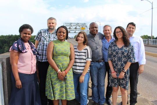 A group of foreign visitors had their photos taken at the historic Edmund Pettus Bridge in Selma. Alvin Benn/Special to the Advertiser