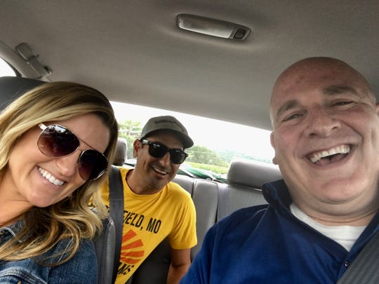 "The Tennessean's Brad Schmitt, right, takes a road trip Aug. 17, 2018, to taste the biscuits at Beacon Light Tea Room in Bon Aqua, Tenn., with two media personalities. Kelly Sutton, left, from Channel 4's ""Today in Nashville,"" and Producer Eddie from syndicated country radio's The Bobby Bones Show come along for the ride."