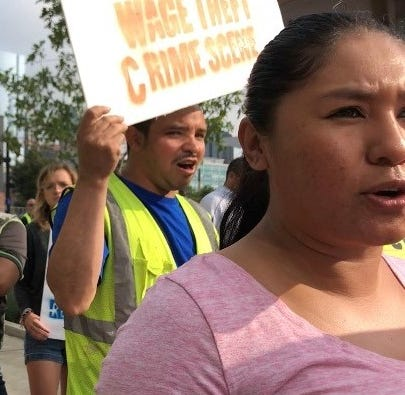 Construction workers protest outside JW Marriott for unpaid wages