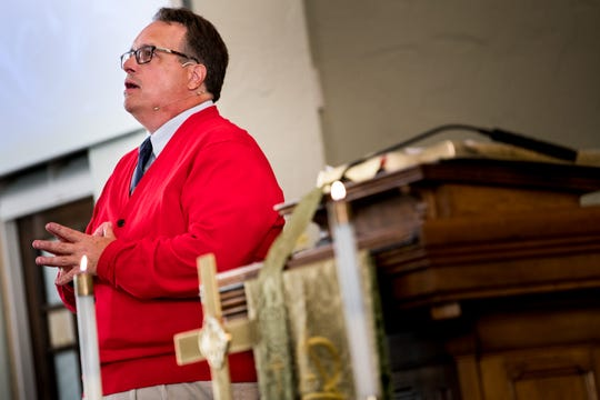 Wearing a Mr. Rogers inspired cardigan, Pastor Jay Voorhees leads a service at City Road Chapel United Methodist Church in Madison on Sunday, Aug. 19, 2018. Voorhees led a three-part series on Rogers and the self-worth, kindness and neighborliness he taught America for decades on public television.