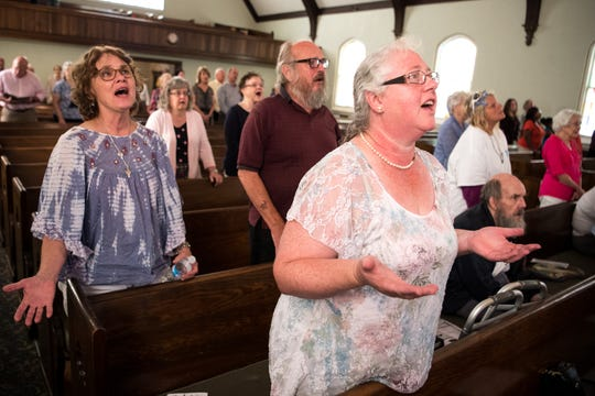 Esther Walden, right, joins the rest of the congregation in song during a service at City Road Chapel United Methodist Church in Madison on Sunday, Aug. 19, 2018.