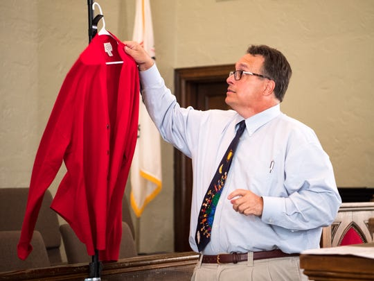 Pastor Jay Voorhees hangs up his red cardigan after a service at City Road Chapel United Methodist Church in Madison on Sunday, Aug. 19, 2018. Voorhees led a three-part series on Rogers and the self-worth, kindness and neighborliness he taught America for decades on public television.