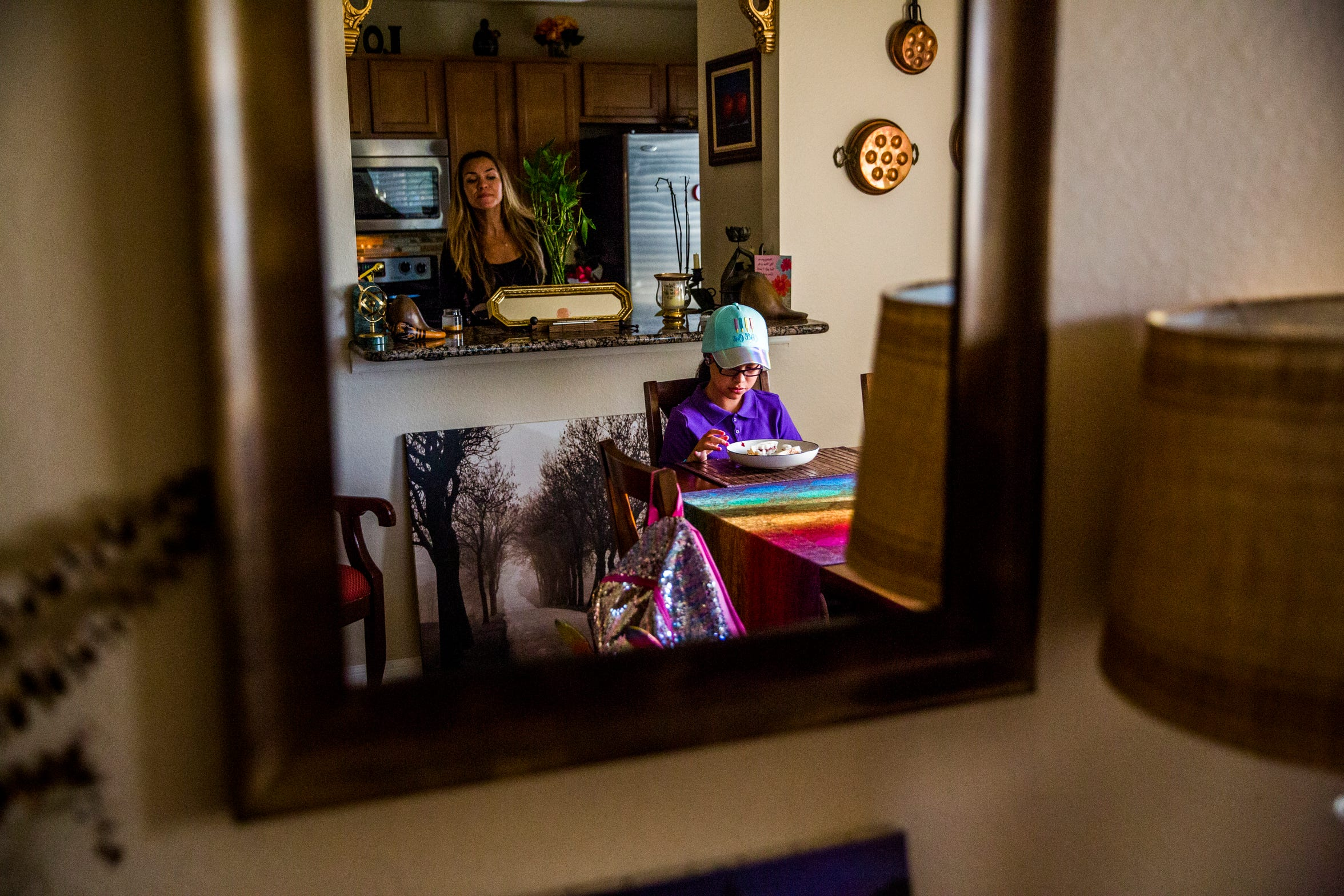 Marcela Guimoye checks on her daughter Camila Chang, 11, as she eats breakfast before school in their North Naples home on Thursday, Aug. 16, 2018. After Camila was diagnosed with autism, Guimoye got her master's degree in behavioral analysis in order to better understand her daughter's diagnosis and how to be there for her. Guimoye says that her degree also gave her the foundational knowledge to start EndlessBrain.