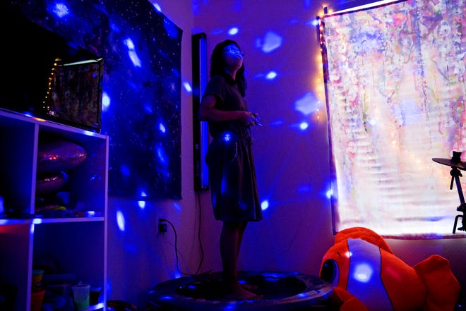 "Camila Chang, 11, listens to music in her ""sensory room"" in her North Naples home on Tuesday, Aug. 14, 2018. Camila was diagnosed with autism when she was 2½ years old and goes to her ""sensory room"" to immerse herself in music. Because of Camila's love for music and the lack of services for kids with autism in Southwest Florida, Camila's mother, Marcela Guimoye, started a nonprofit called EndlessBrain. EndlessBrain provides music opportunities for kids with special needs. ""My expectations for EndlessBrain is to make Camila as happy as possible and give kids like her the same opportunity,"" Guimoye says."