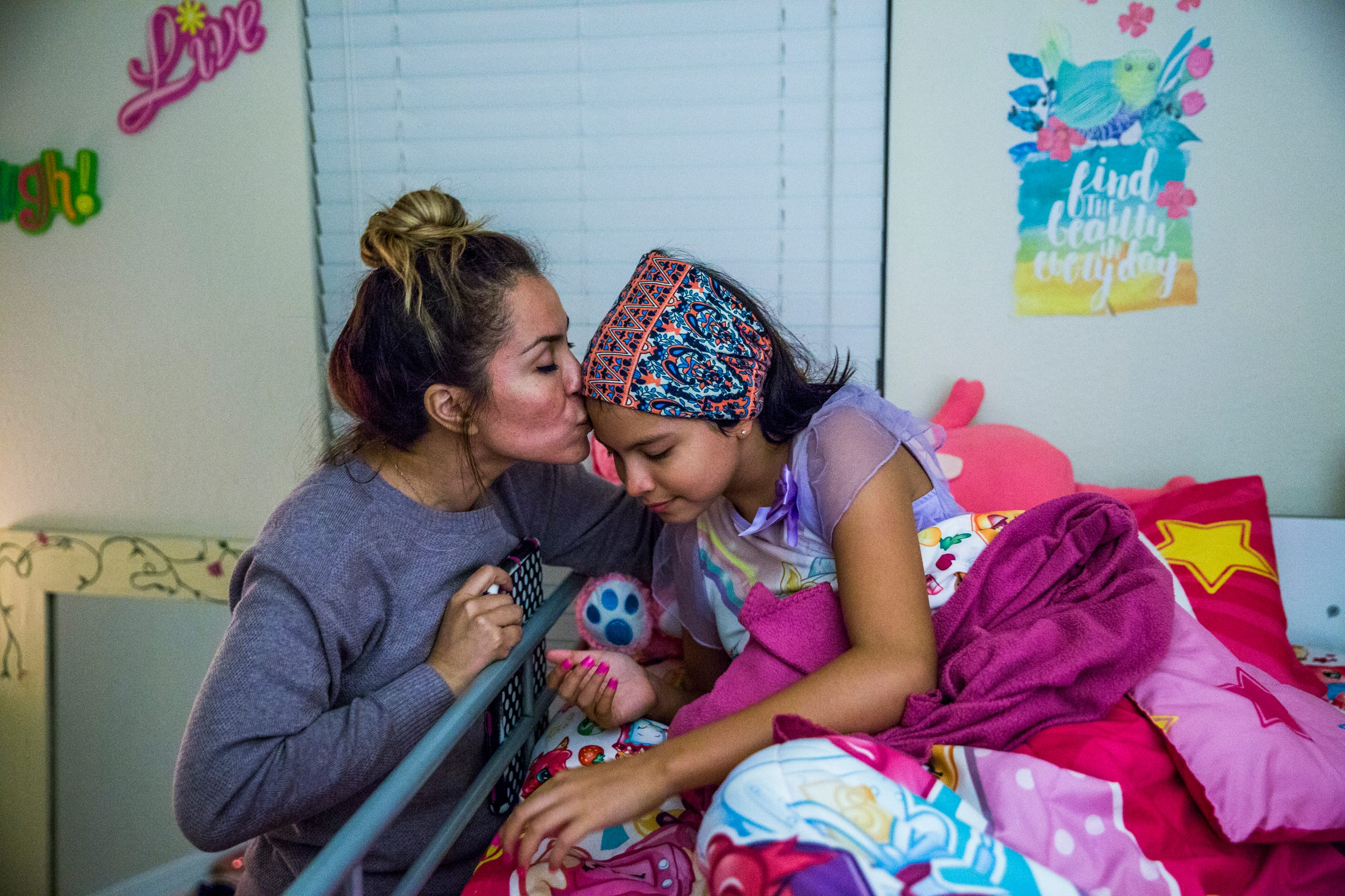 Marcela Guimoye kisses her daughter Camila Chang, 11, goodnight in their North Naples home on Tuesday, Aug. 14, 2018.