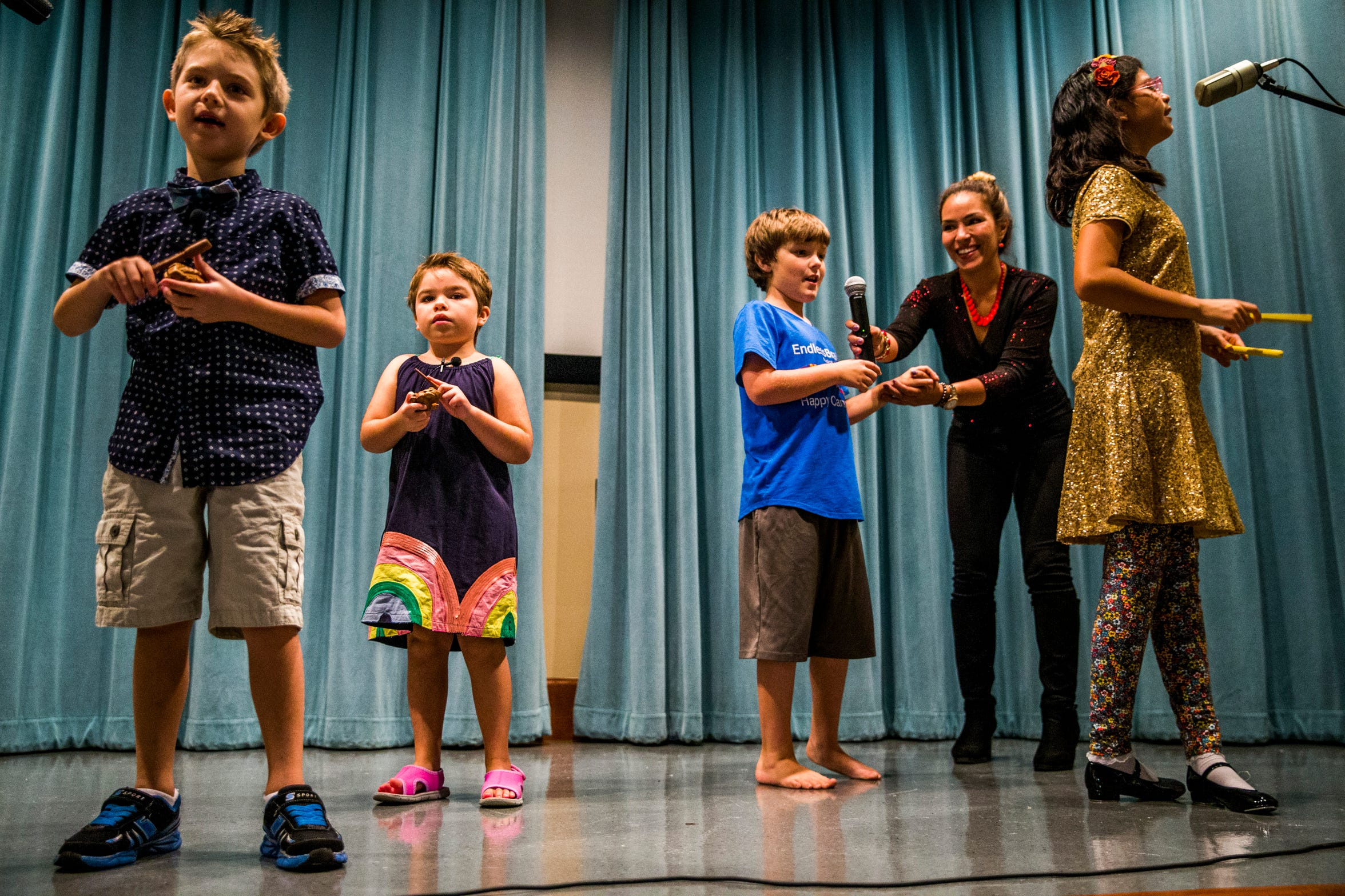 "EndlessBrain campers sing during a recital for their friends and family with the help of Marcela Guimoye at the Collier County Library in North Naples on Saturday, Aug. 11, 2018. ""This is a place for parents to feel like their kids with special needs are safe and know that their kids are loved,"" Guimoye says."