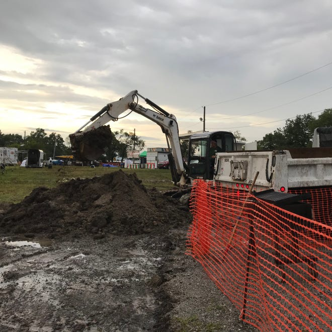 Crews from Passaic County worked into the night on Saturday to remove mud and add crushed stones to get the fair grounds in shape for the final day of the fair.