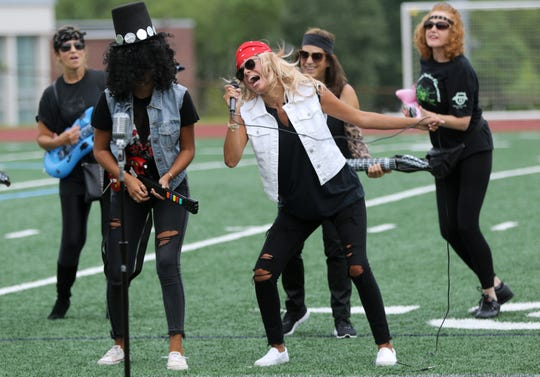 Grace and Rose D'Annibale, of Waldwick, perform as, Slash and Axl Rose during the air band competition during a memorial for Sean Fisher, Sunday, August 19, 2018.