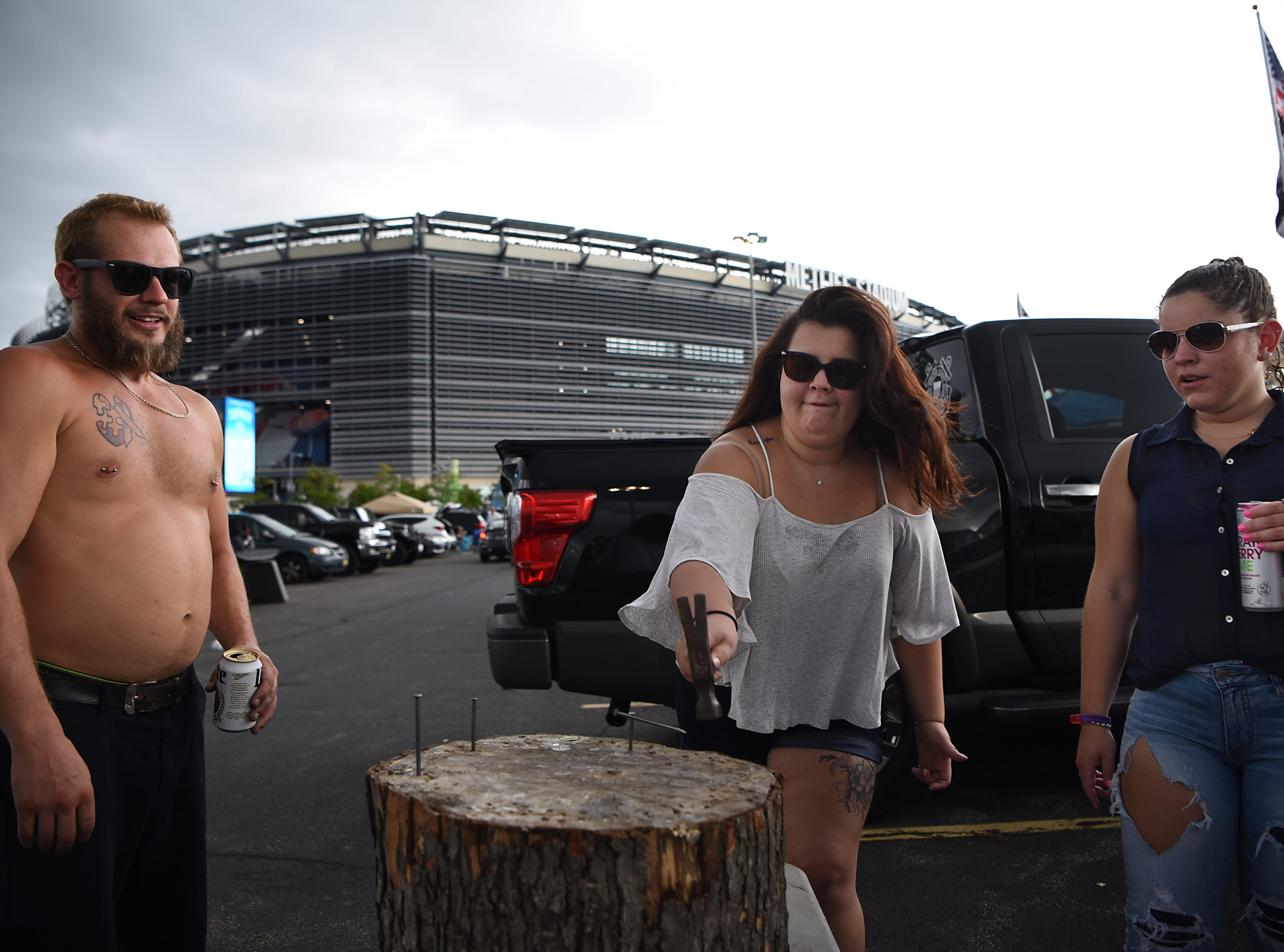A group plays stump in the parking lot prior to the Kenny Chesney concert at MetLife stadium in East Rutherford on Saturday August 18, 2018. (From left) Matt Coccurello from Long Branch, Steffany Santos from Old Bridge and Bianca Dos Santos from