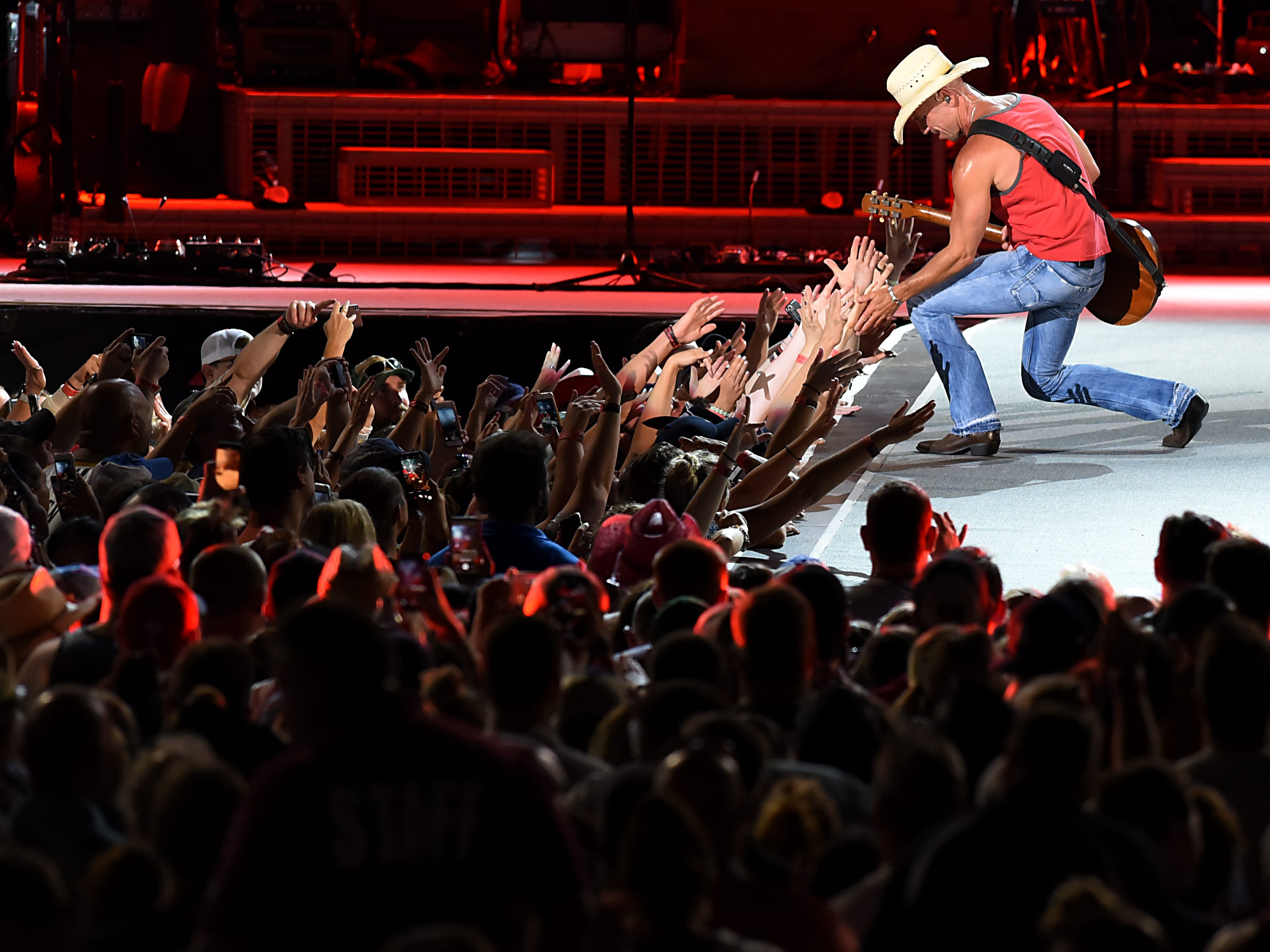 Kenny Chesney greets fans during a concert at MetLife stadium in East Rutherford on Saturday August 18, 2018.