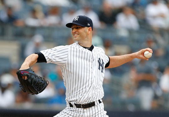 New York Yankees starting pitcher J.A. Happ pitches in the first inning of a baseball game against Toronto Blue Jays, Sunday, Aug. 19, 2018 in New York.