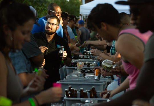 Kevin Chavez, of Las Cruces, grabs a beer from one of various vendors during the 2018 Las Cruces Summer Beer Festival and Salsa Fest at Plaza de Las Cruces on Saturday, August 18, 2018.