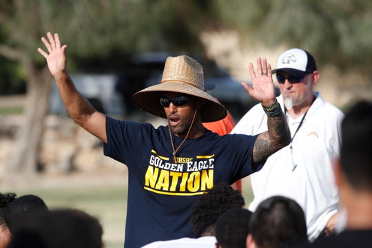 Desert Hot Springs football coach Errol Wilson speaks with his team during a practice this month.