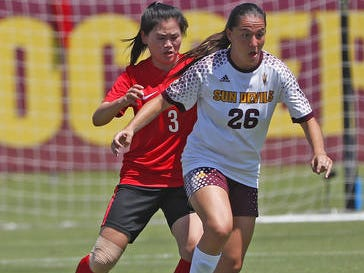 ASU's Natalie Stephens (26) dribbles against Beijing Normal's Jianhui Shao (3) during a game at Sun Devil Soccer Stadium in Tempe, Ariz. on Aug. 18, 2018.