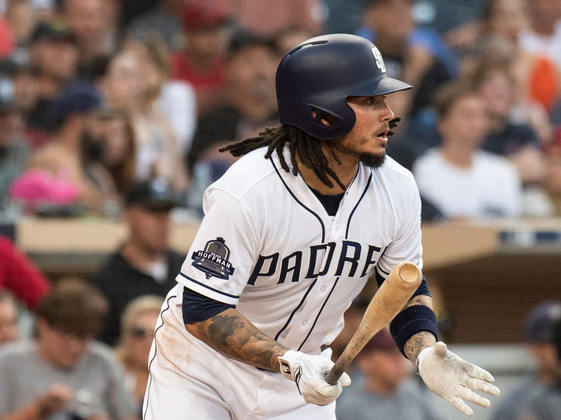 San Diego Padres' Freddy Galvis hits a two-run single during the fourth inning of a baseball game against the Arizona Diamondbacks in San Diego, Saturday, Aug. 18, 2018. (AP Photo/Kyusung Gong)