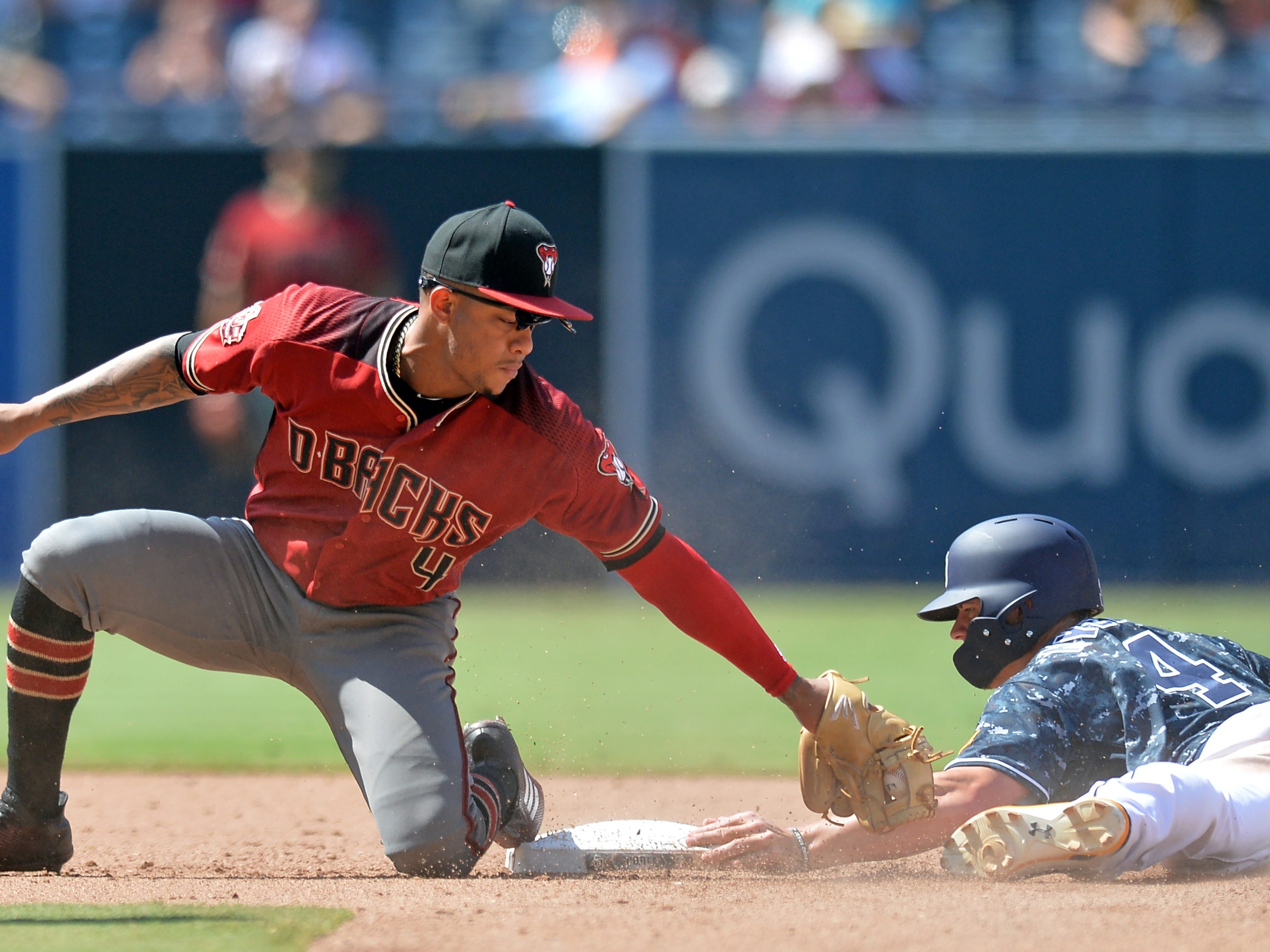 Aug 19, 2018; San Diego, CA, USA; Arizona Diamondbacks shortstop Ketel Marte (4) cannot get the tag on San Diego Padres third baseman Wil Myers (4) in time as Myers steals second in the sixth inning at Petco Park. Mandatory Credit: Jake Roth-USA TODAY Sports