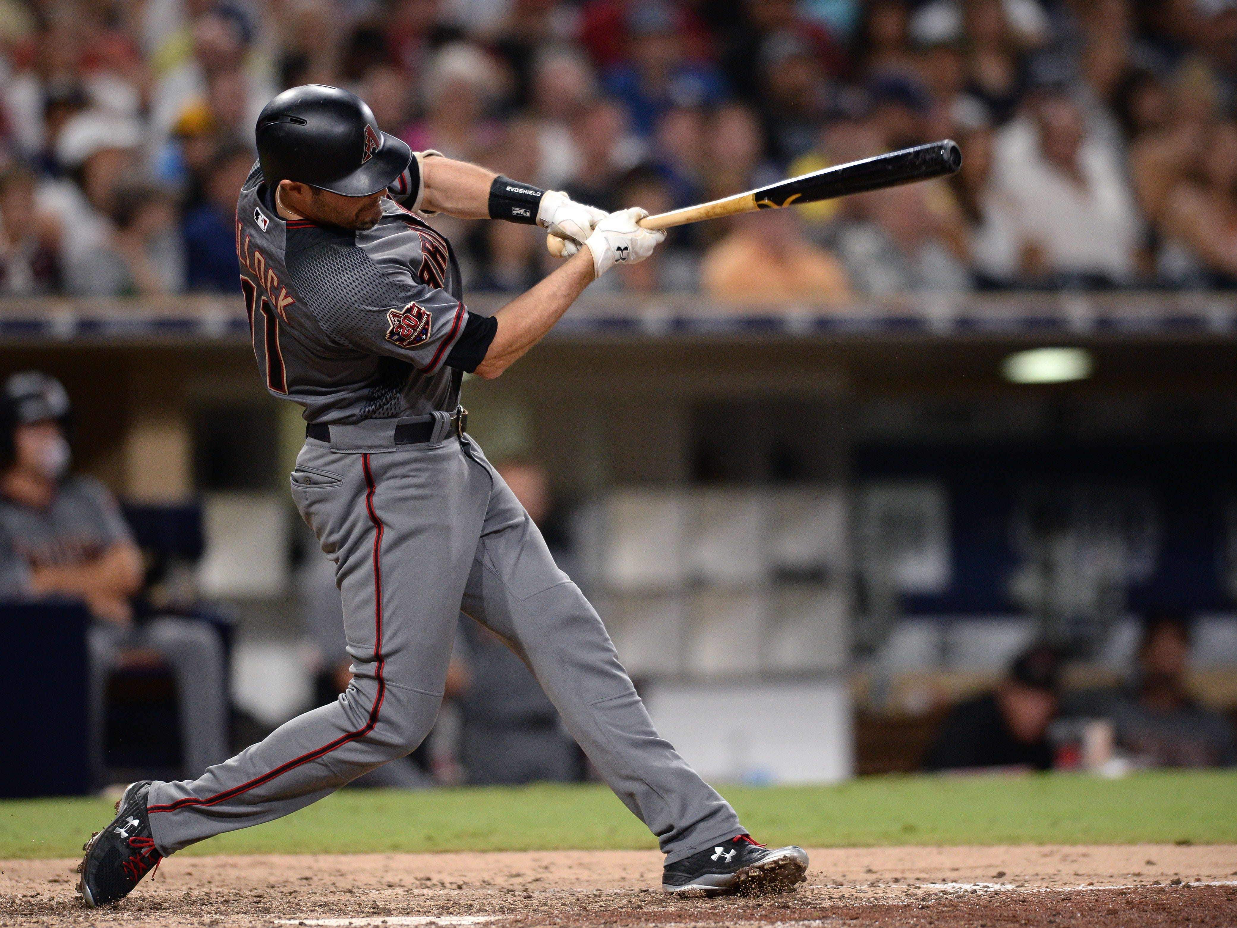 Aug 18, 2018: Arizona Diamondbacks center fielder A.J. Pollock hits a double during the seventh inning against the San Diego Padres at Petco Park.