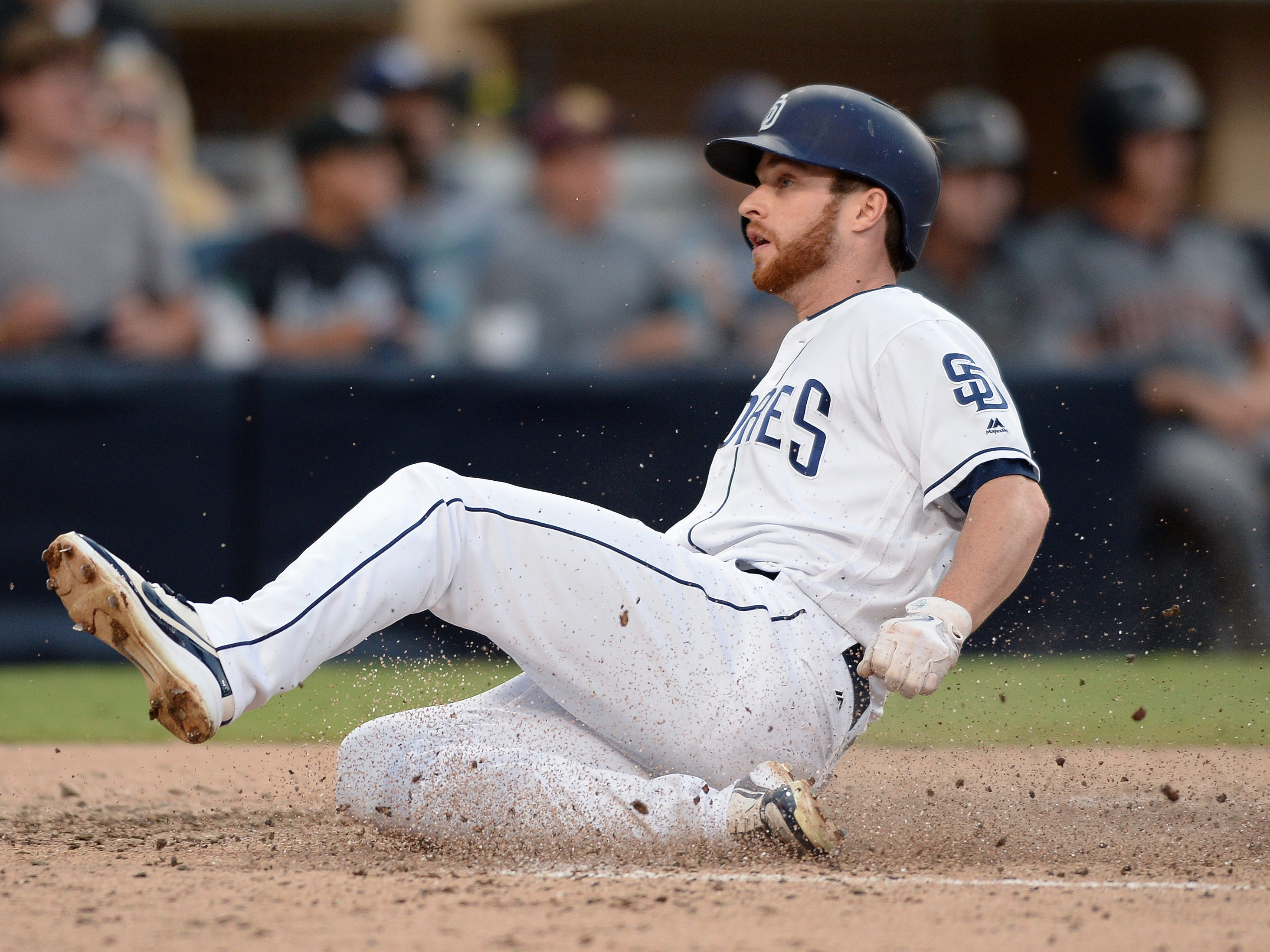 Aug 18, 2018: San Diego Padres second baseman Cory Spangenberg slides home safely on a sacrifice fly by center fielder Manuel Margot (not pictured) during the fourth inning against the Arizona Diamondbacks at Petco Park.