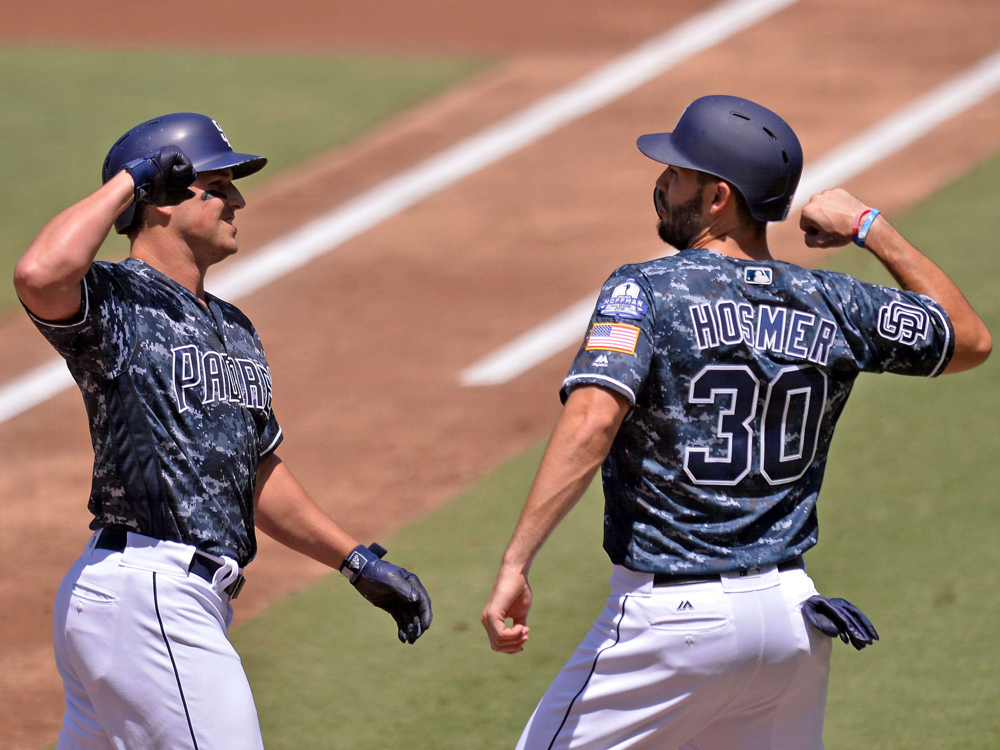 Aug 19, 2018; San Diego, CA, USA; San Diego Padres left fielder Hunter Renfroe (left) and first baseman Eric Hosmer (30) celebrate after Renfroe hit a two-run home run during the first inning against the Arizona Diamondbacks at Petco Park. Mandatory Credit: Jake Roth-USA TODAY Sports