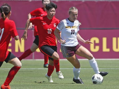 ASU's Jemma Purfield (11) dribbles against Beijing Normal's Huan Wang (10) during a game at Sun Devil Soccer Stadium in Tempe, Ariz. on Aug. 18, 2018.