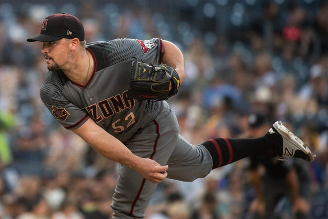 Arizona Diamondbacks starting pitcher Zack Godley delivers a pitch during the third inning of a baseball game against the San Diego Padres in San Diego, Saturday, Aug. 18, 2018. (AP Photo/Kyusung Gong)