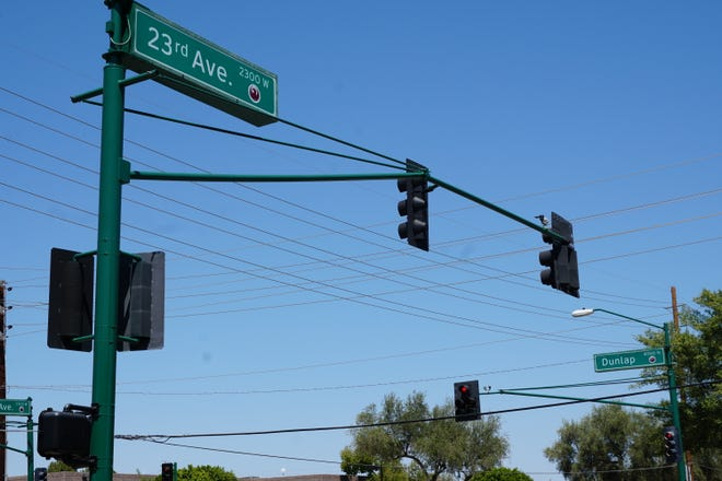 Street signs at 23rd and Dunlap avenues in Phoenix.