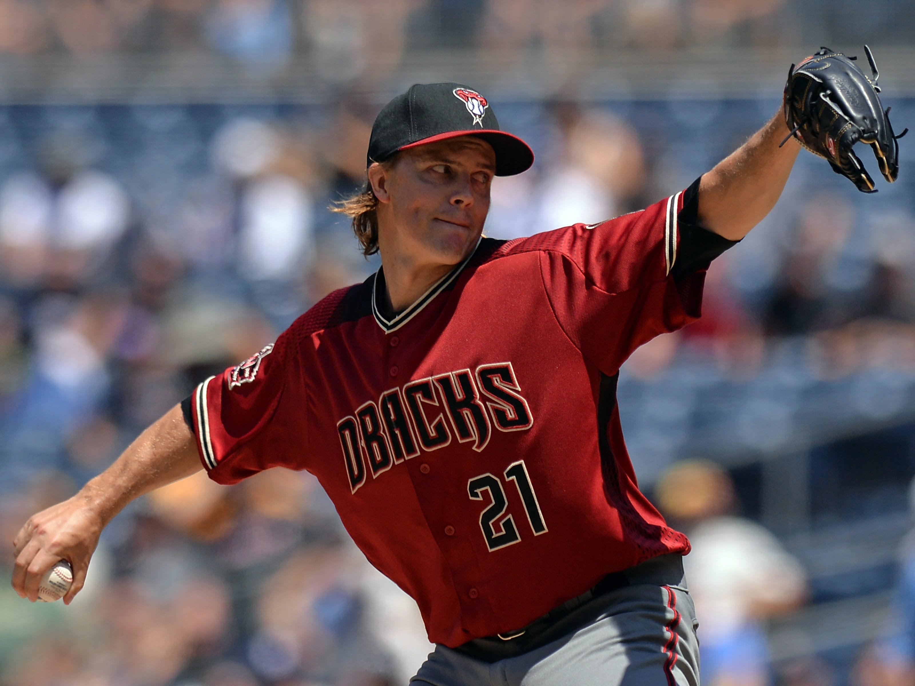 Aug 19, 2018; San Diego, CA, USA; Arizona Diamondbacks starting pitcher Zack Greinke (21) pitches during the first inning against the San Diego Padres at Petco Park. Mandatory Credit: Jake Roth-USA TODAY Sports