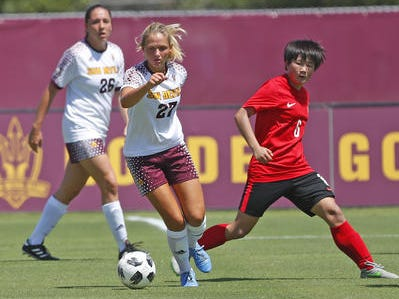 ASU's Marleen Schimmer (27) dribbles away form Beijing Normal's Rong Zhang (8) during a game at Sun Devil Soccer Stadium in Tempe, Ariz. on Aug. 18, 2018.