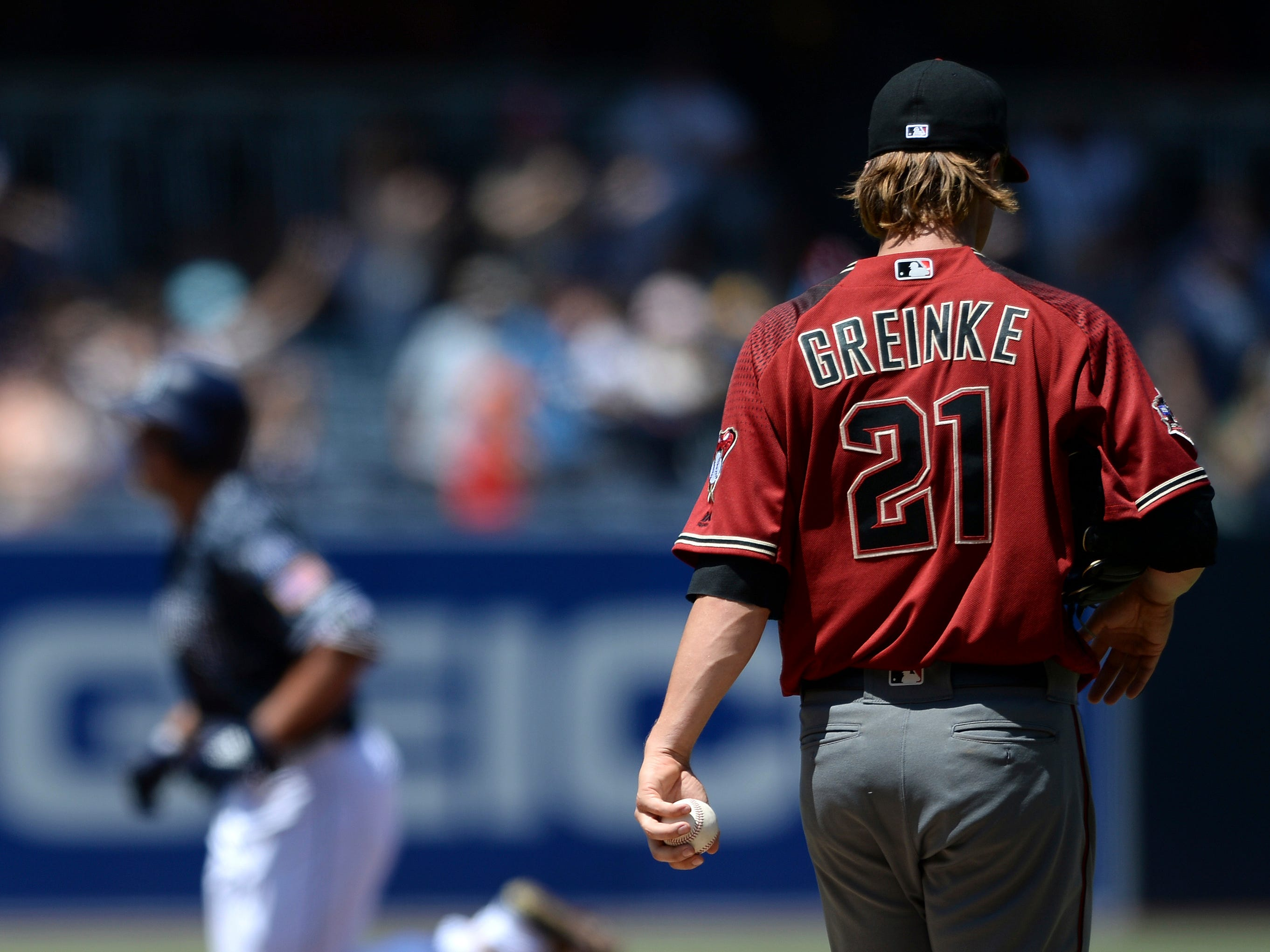 Arizona Diamondbacks starting pitcher Zack Greinke (21) reacts on the mound as San Diego Padres' Hunter Renfroe rounds the bases after hitting a two-run home run during the first inning of a baseball game Sunday, Aug. 19, 2018, in San Diego.