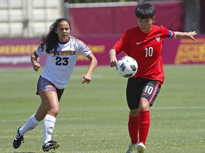 ASU's Olivia Nguyen (23) defends Beijing Normal's Huan Wang (10) during a game at Sun Devil Soccer Stadium in Tempe, Ariz. on Aug. 18, 2018.