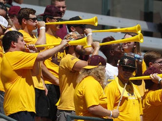 ASU fans play vuvuzuelas during a game at Sun Devil Soccer Stadium in Tempe, Ariz. on Aug. 18, 2018.