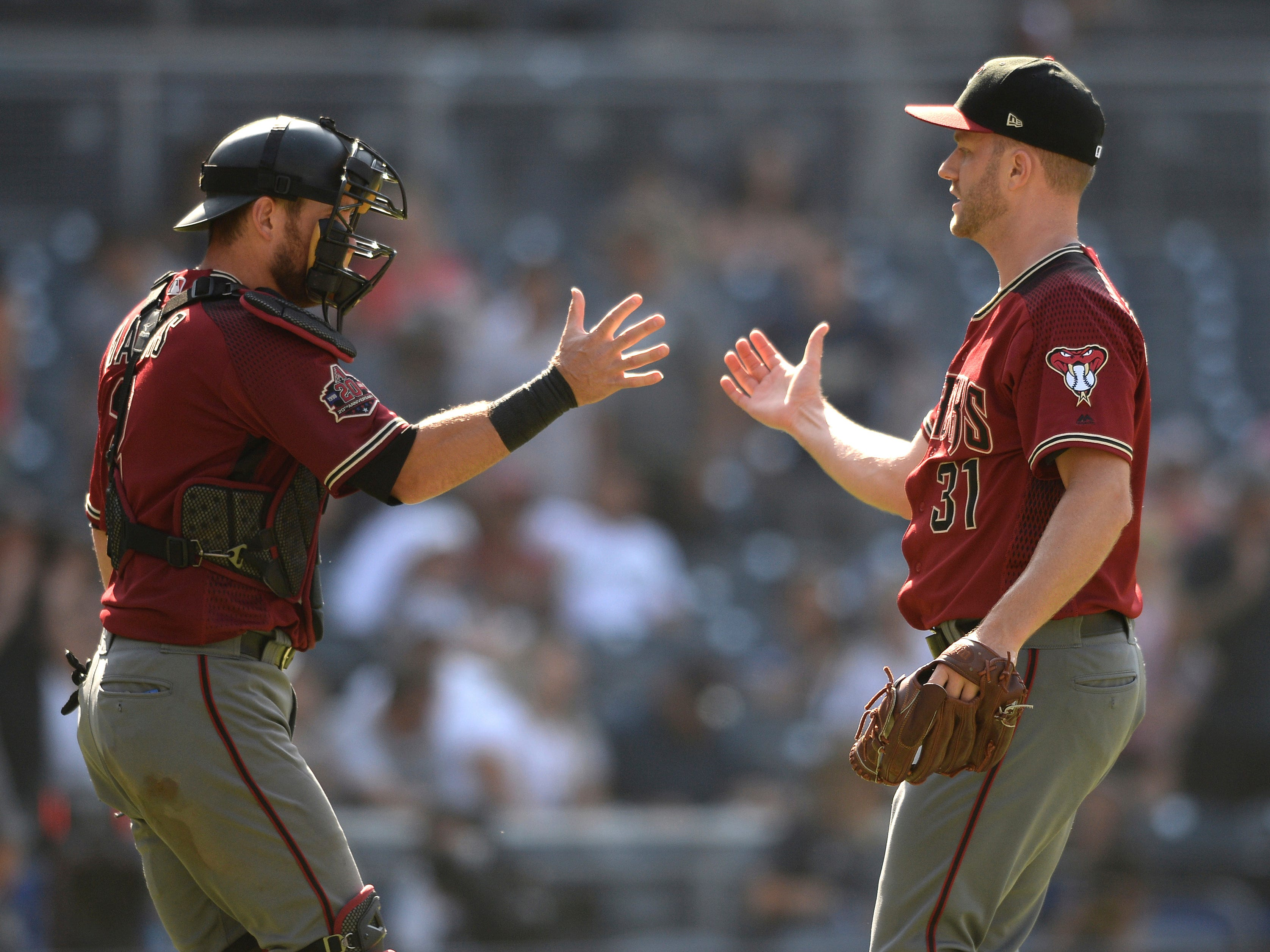 Arizona Diamondbacks' Brad Boxberger, right, and Jeff Mathis celebrate after recording the last out of a baseball game against the San Diego Padres, Sunday, Aug. 19, 2018, in San Diego. (AP Photo/Orlando Ramirez)
