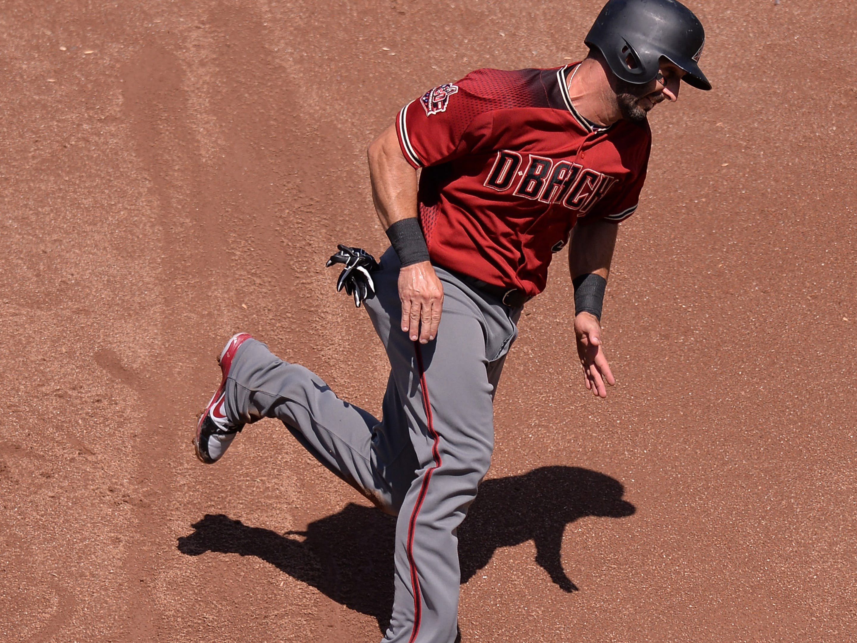 Aug 19, 2018; San Diego, CA, USA; Arizona Diamondbacks second baseman Daniel Descalso (3) rounds third to score on a single by catcher Jeff Mathis (not pictured) during the second inning against the San Diego Padres at Petco Park. Mandatory Credit: Jake Roth-USA TODAY Sports