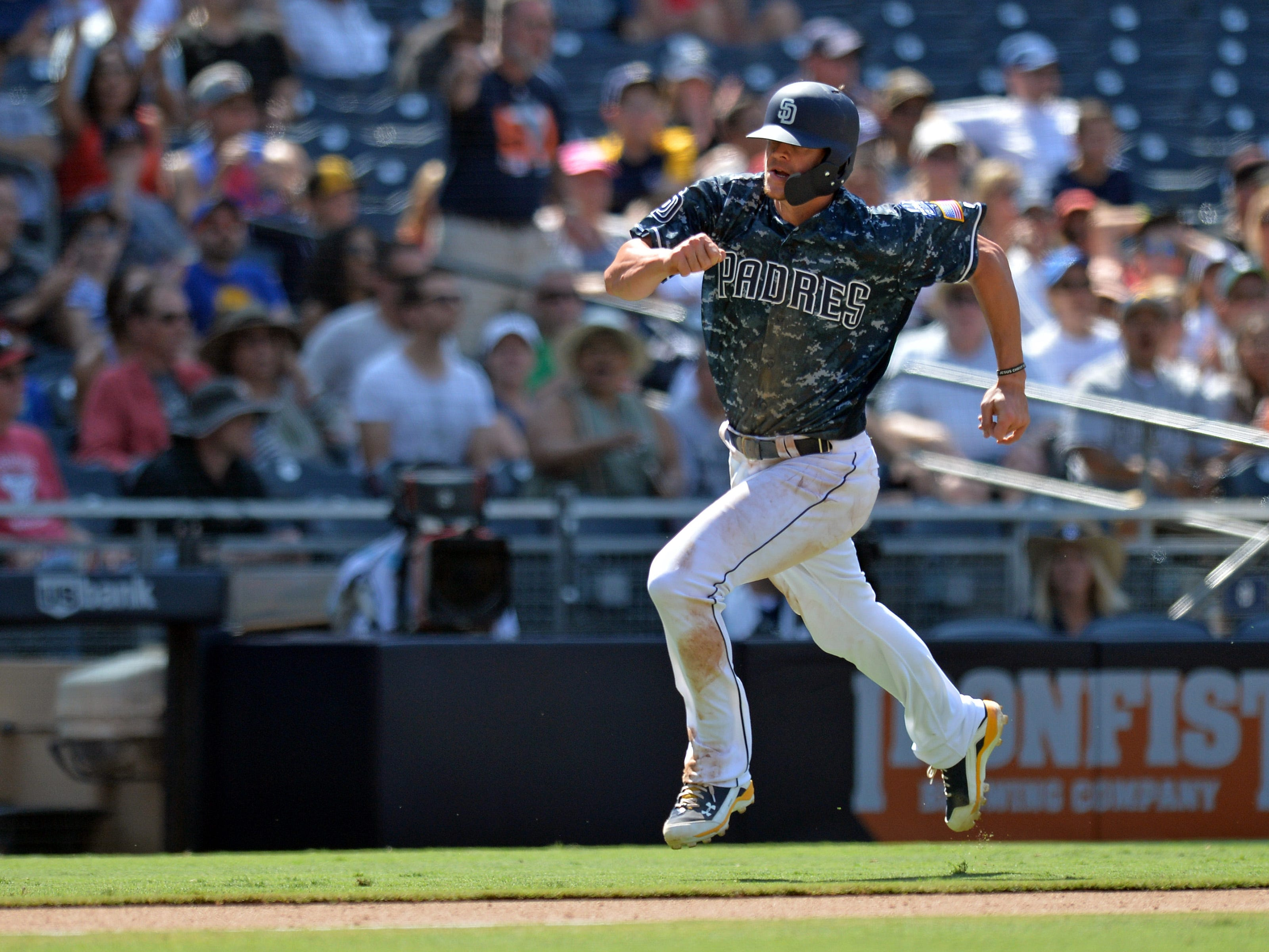Aug 19, 2018; San Diego, CA, USA; San Diego Padres third baseman Wil Myers (4) scores on a single by left fielder Hunter Renfroe (not pictured) in the sixth inning against the Arizona Diamondbacks at Petco Park. Mandatory Credit: Jake Roth-USA TODAY Sports
