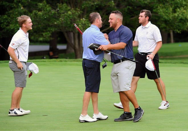 Chris Gebhard, second from left, gets a hand shake from Tyler Massar after Gebhard and his partner Noah Firestone, left, closed the quarterfinal match on the 18th green during play Saturday August 18, 2018 at the 73rd.W.B. Sullivan Invitational at the Lebanon Country Club.Tyler Massar's partner was Brady Demey (far right).
